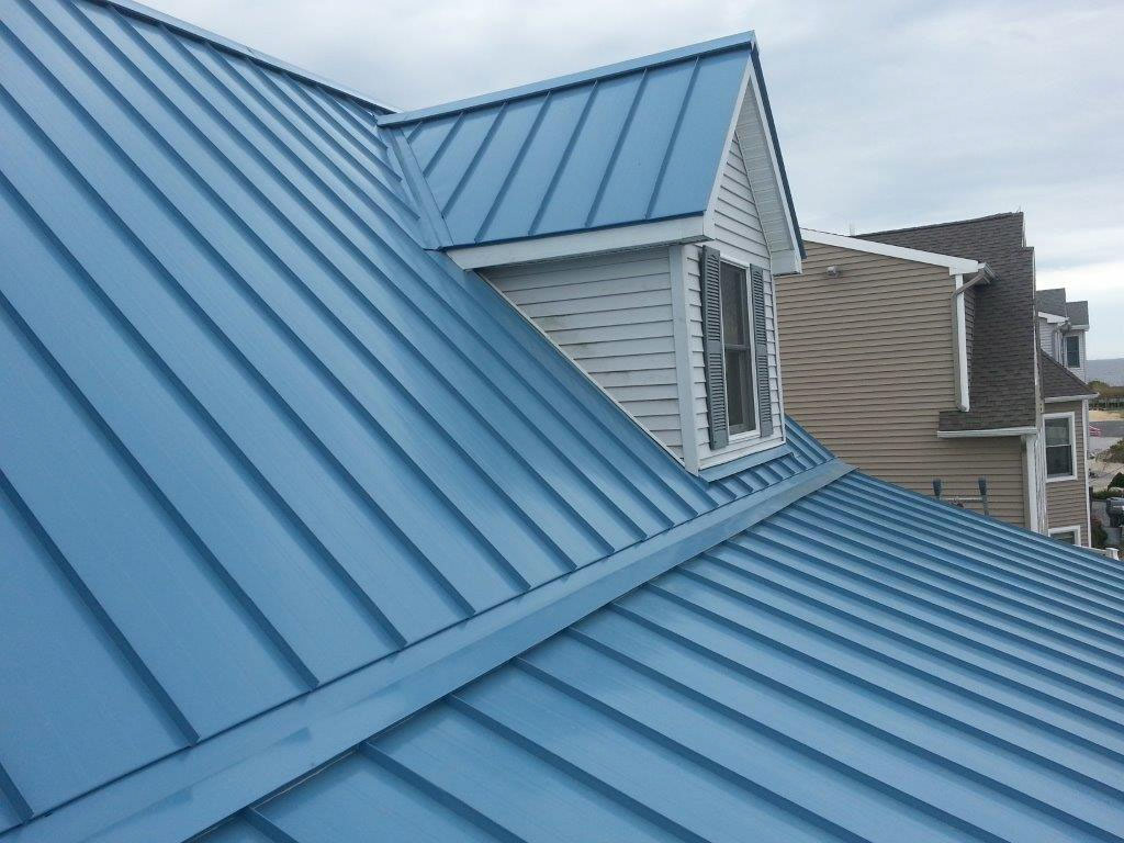 The beauty of metal roofs exterior renovations madison for Steel roof paint